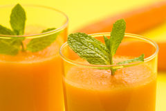 Fresh carrot juice and mint. Delicious and fresh carrot juice and mint Royalty Free Stock Photography