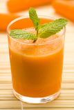 Fresh carrot juice and mint. Delicious and fresh carrot juice and mint Royalty Free Stock Image