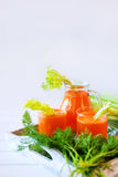 Fresh carrot juice poured into glasses and green celery Royalty Free Stock Photos