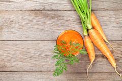 Fresh carrot juice smoothie and roots Stock Image