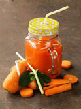 Fresh carrot juice (smoothies) in a glass jar. Healthy food royalty free stock photography