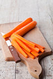 Fresh carrot and knife Stock Images