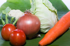 Fresh Carrot onion  tomato Cauliflower  collard  isolated on banana leaf Stock Image