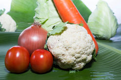Fresh Carrot onion  tomato Cauliflower  collard  isolated on banana leaf Stock Photography