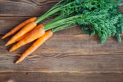 Fresh carrot on rustic wooden background Stock Image