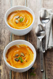 Fresh carrot soup in white bowl, dietary vegetable soup Stock Images