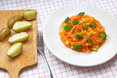Fresh carrot spaghetti with broccoli, corns and baked potatoes Royalty Free Stock Images