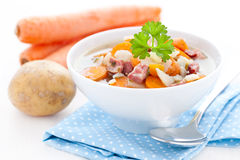 Fresh carrot stew with smoked pork Stock Images