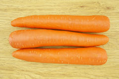 Fresh carrot wood background Stock Photography