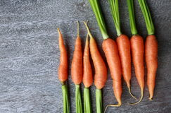 Fresh carrot on wooden table. Stock Photography