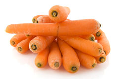 Fresh carrots. Pile of Fresh carrots isolated over white background Royalty Free Stock Photo
