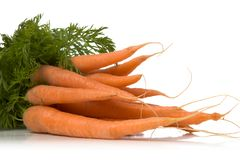 Fresh carrots. Bunch of fresh carrots isolated over white background Stock Photography
