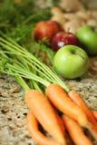 Fresh carrots apples & ginger. Shot of fresh carrots apples & ginger Stock Images
