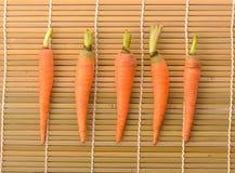 Fresh carrots on  bamboo floor Stock Photo
