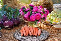 Fresh carrots, beets, physalis and pink asters. On the burlap background Stock Image