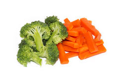 Fresh carrots and broccoli on a white background Stock Images