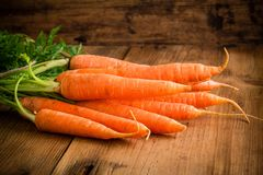 Fresh carrots bunch on wood Stock Photo