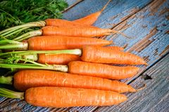Fresh carrots bunch on wooden background royalty free stock photos