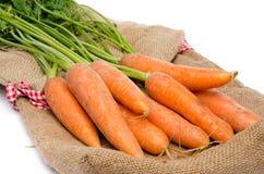 Fresh carrots on a burlap bag Stock Photo