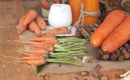 Fresh carrots and carrot juice are delicious. Stock Image