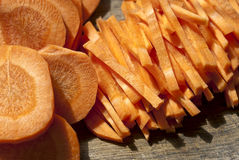 Fresh carrots cut into strips. And circles is photographed close-up Stock Image
