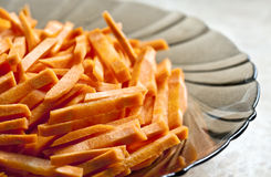 Fresh carrots cut into strips. Lay on a glass plate, photography close-up Royalty Free Stock Photo