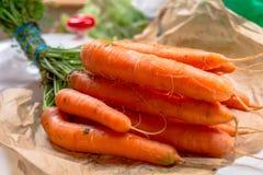 Fresh carrots. Freshly harvested carrots at farmer`s market Royalty Free Stock Photo