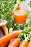 Fresh carrots and healthy juice Royalty Free Stock Images