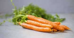 Fresh carrots heap royalty free stock photos