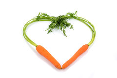 Fresh carrots in a heart shape Royalty Free Stock Images