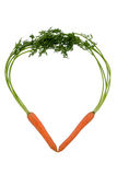 Fresh carrots in a heart shape Royalty Free Stock Photos