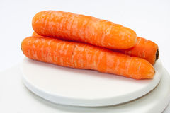 Fresh carrots on a kitchen digital scale Stock Photo