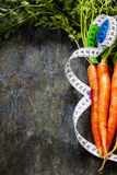 Fresh carrots measurement tape Royalty Free Stock Photo