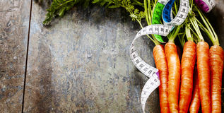 Fresh carrots measurement tape Royalty Free Stock Image