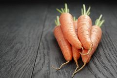 Fresh carrots on old oak table with copy space for Royalty Free Stock Photos