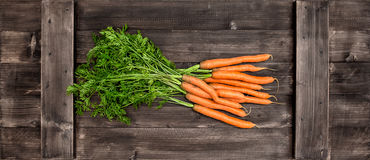 Fresh carrots over wooden background. Vegetable. Food Stock Image