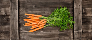 Fresh carrots over wooden background. Vegetable. Food Royalty Free Stock Images