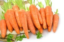 Fresh carrots  on white background, closeup. Fresh carrots with parsley on raw cloth on white background, closeup Royalty Free Stock Photo