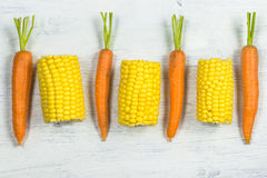 Fresh carrots and sweetcorn Royalty Free Stock Photo