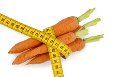 Fresh carrots with tape measure Royalty Free Stock Photos