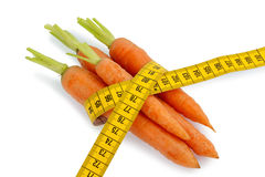 Fresh carrots with tape measure Stock Photography
