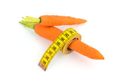 Fresh carrots with tape measure Royalty Free Stock Photo
