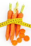 Fresh carrots with tape measure Stock Photos