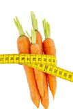 Fresh carrots with tape measure Stock Images