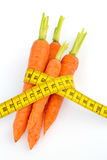 Fresh carrots with tape measure Royalty Free Stock Image