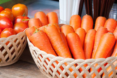 A Fresh carrots and tomato in basket Royalty Free Stock Photography