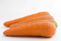 Fresh carrots  on white background. Closeup of carrot Stock Images