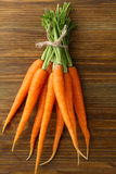 Fresh carrots on wooden background Stock Images