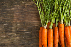 Fresh carrots on wooden background Stock Photography