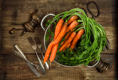 Fresh carrots on wooden background. Vegetable. Vintage style foo Royalty Free Stock Photography
